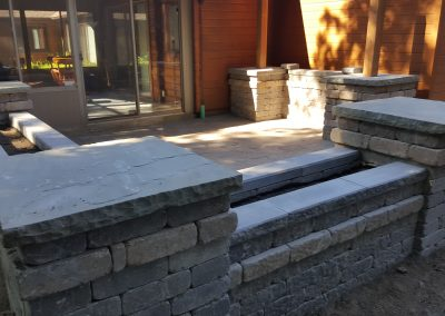 This custom patio seamlessly extends the living space in this project