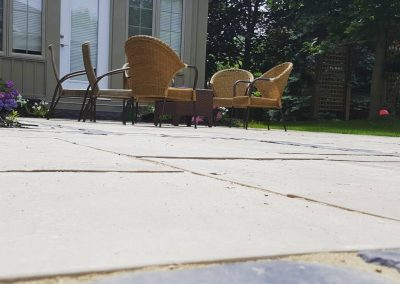 Elegant flagstone style patio by JRC Landscaping