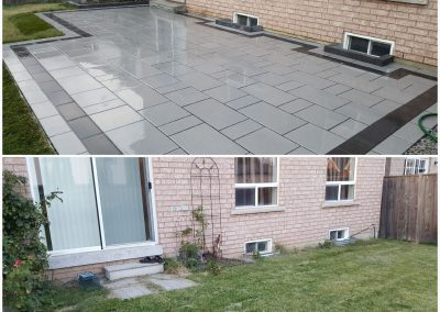 JRC Landscaping New grey stone patio with black border accent